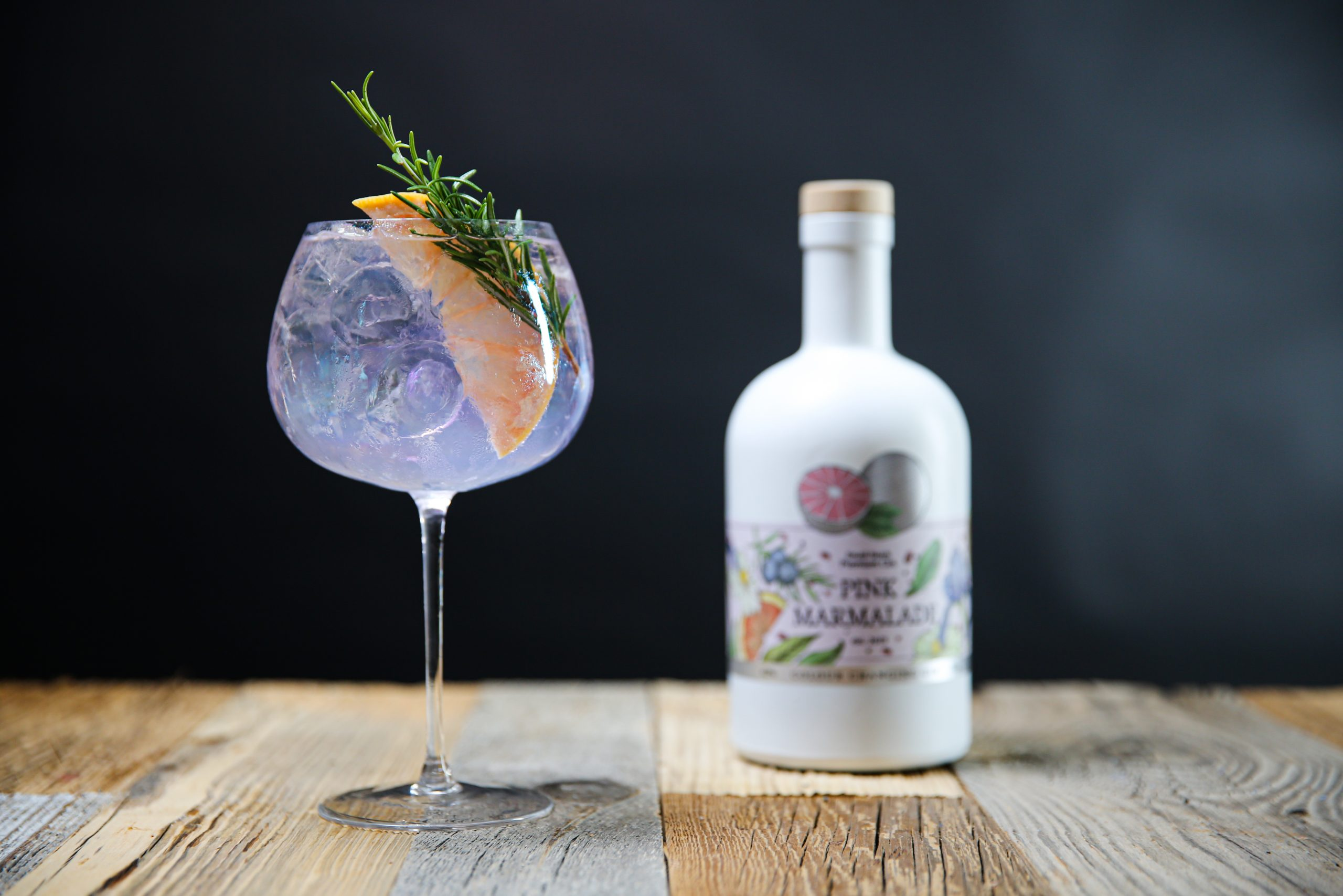gin in balloon glass on table