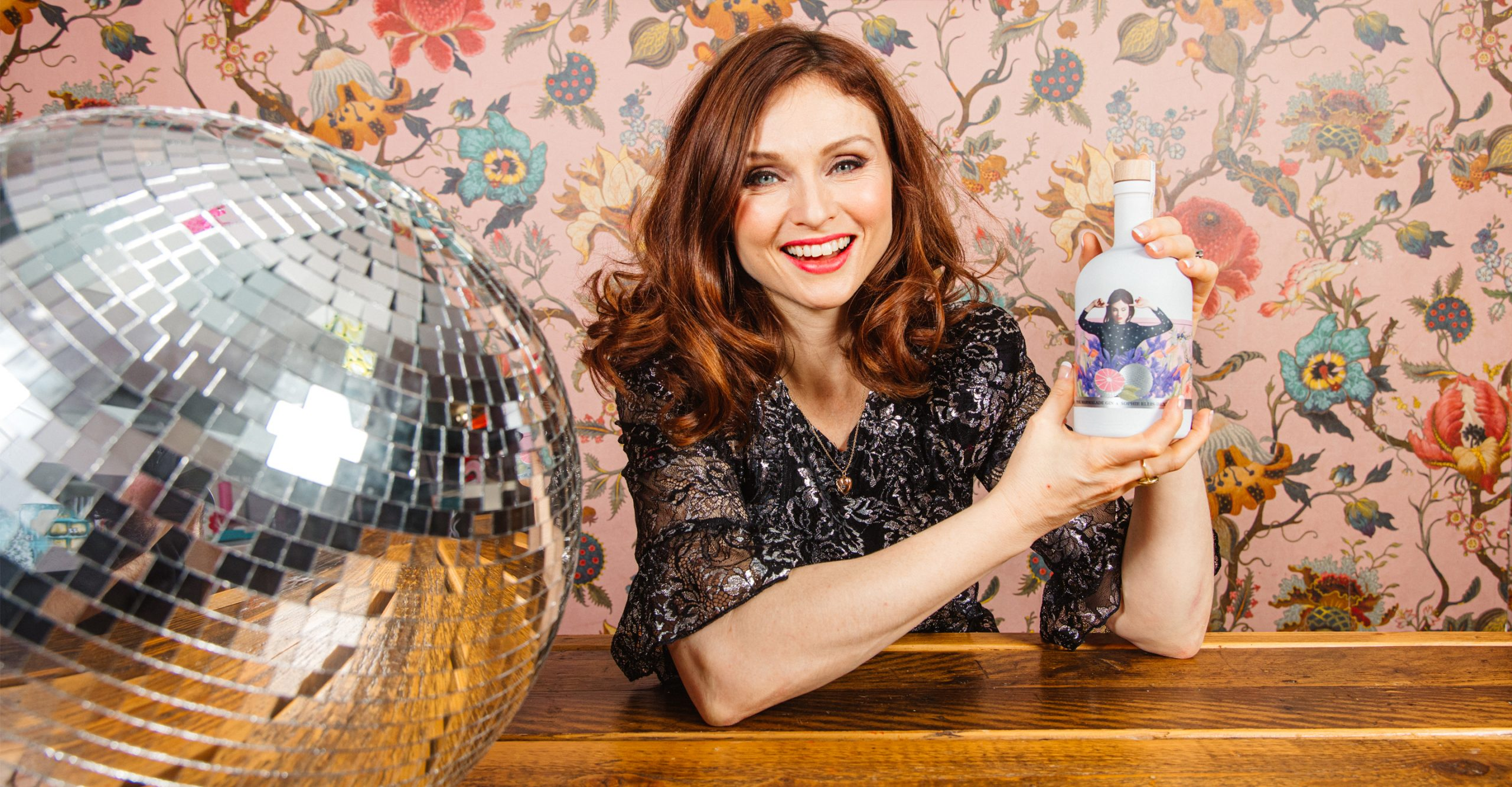 sophie ellis-bextor with pink marmalade gin bottle and disco ball